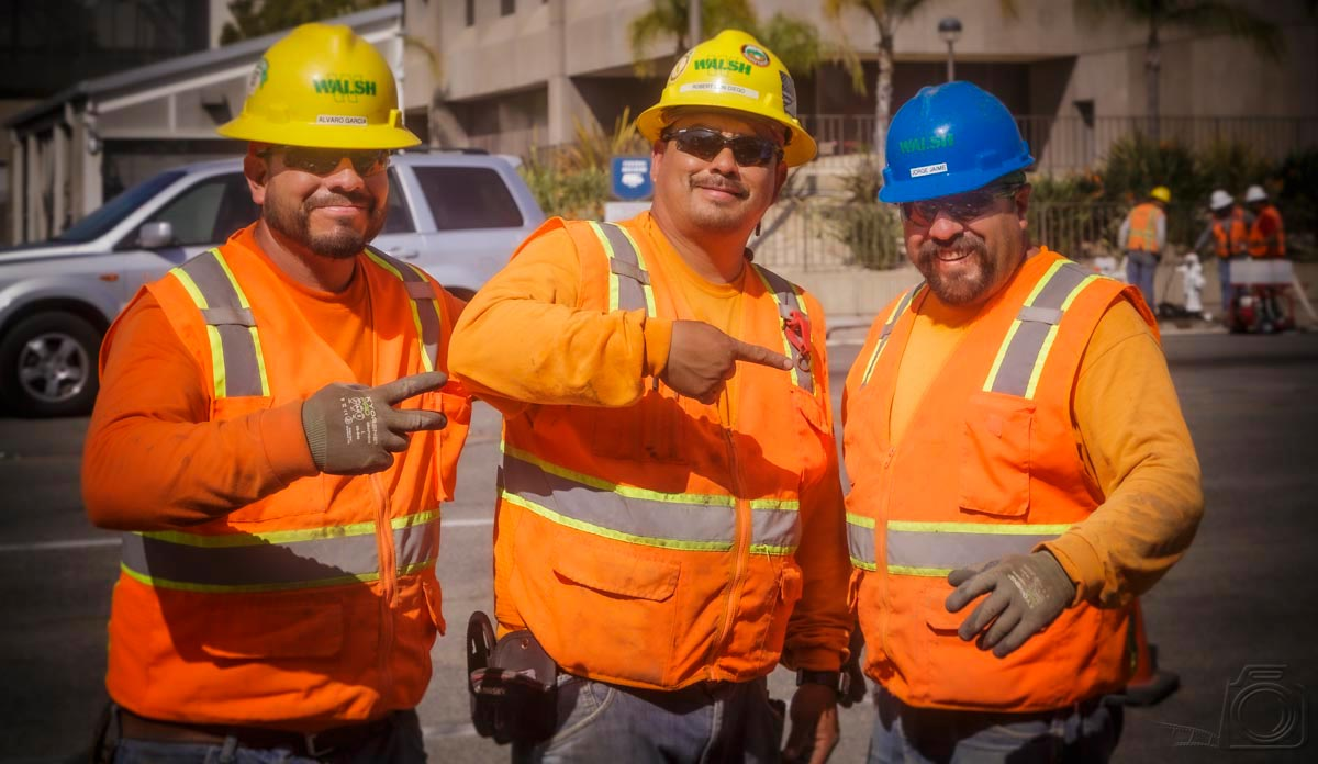 Hazing The Rookie: Group portrait of three construction workers